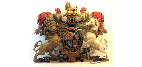Carved oak polychrome Coat of Arms