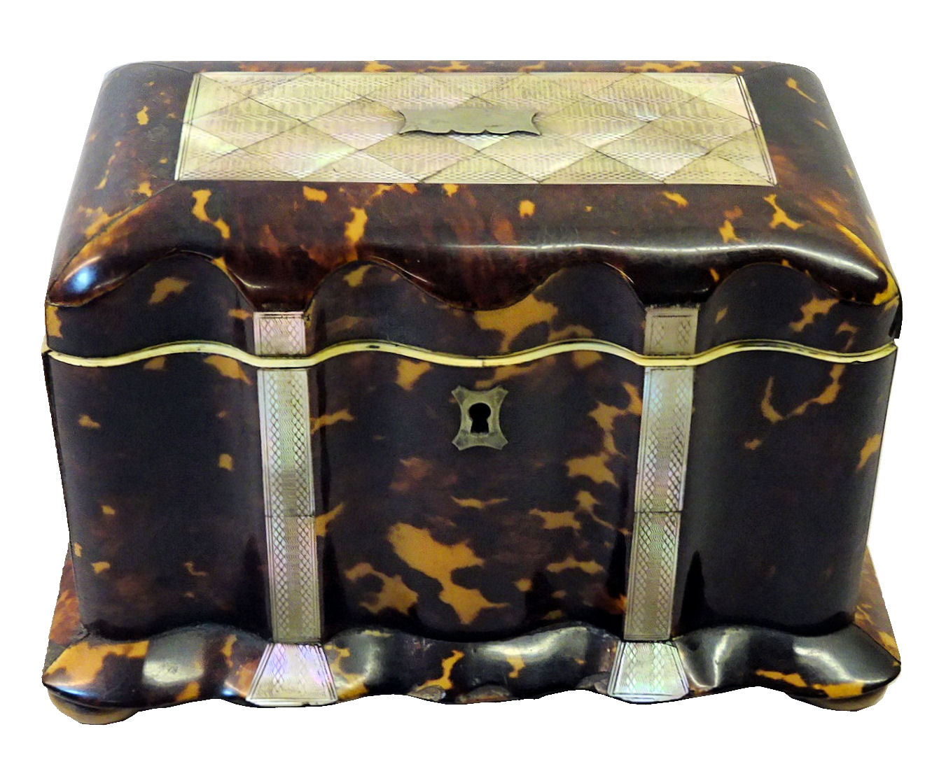 "A mid 19th Century tortoise shell Tea Caddy of serpentine outline, the hinged lid inlaid with a mother of pearl panel and further panels to the front, the interior fitted with two covered containers with mother of pearl lifts and ivory border, raised on four compressed bun feet. 8"" (20 cms) wide."