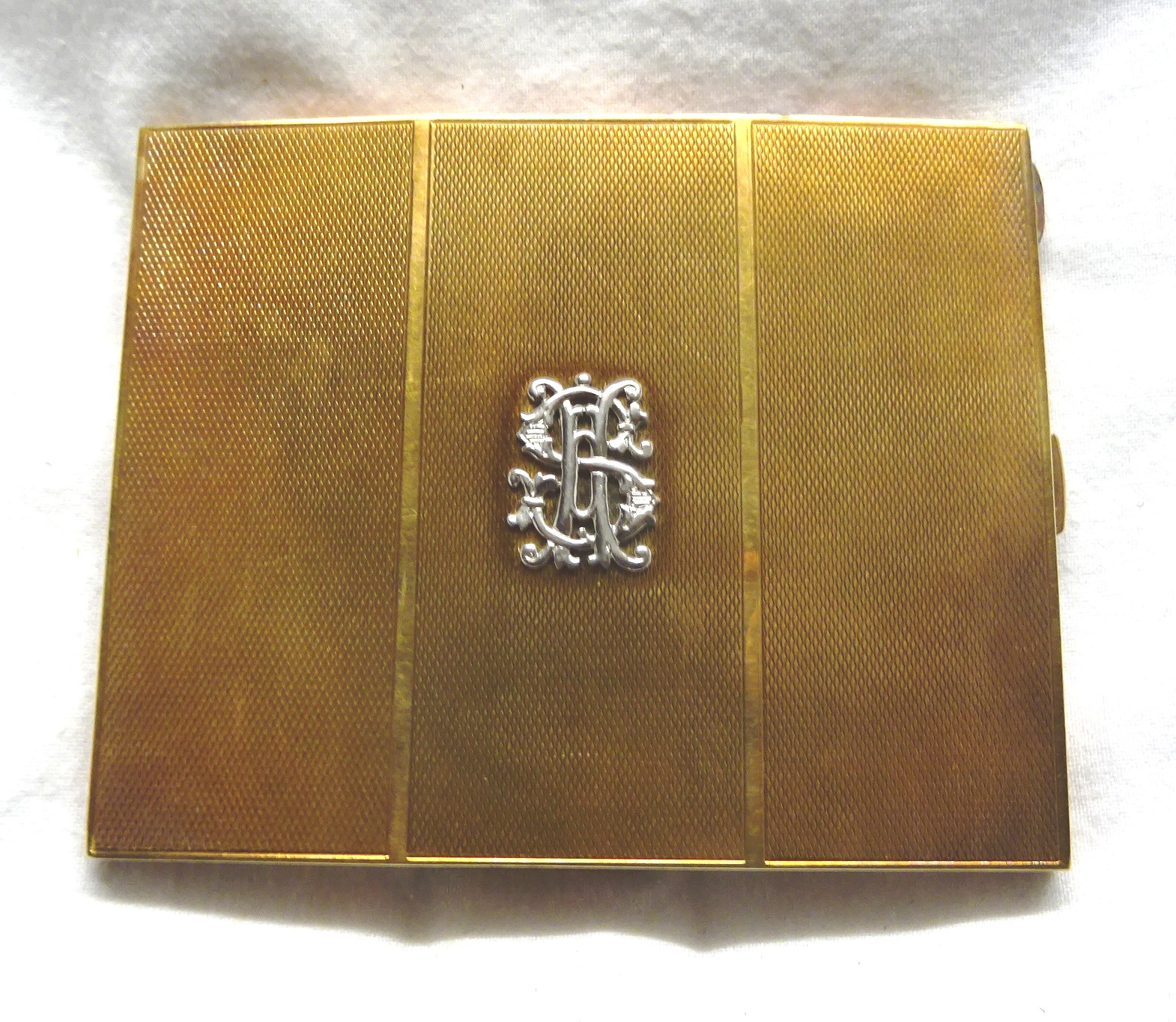 A 14ct. engine turned gold Cigarette Case